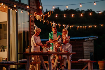 Fototapeta Family at birthday party in the backyard obraz