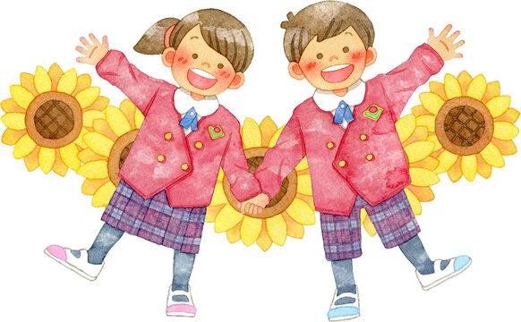 赤い制服を着て手をあげる笑顔の子供たちとひまわり