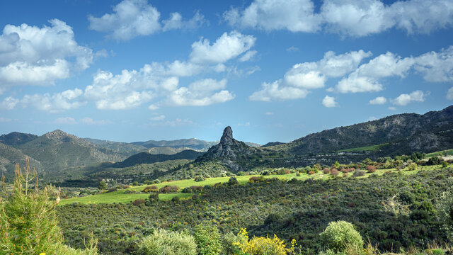 Panoramic view of the river Sirkatis valley with the impressive standalone rock of Kourvellos in the middle (Lefkara area, Cyprus)