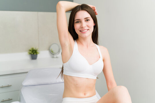 Caucasian woman showing her smooth armpit