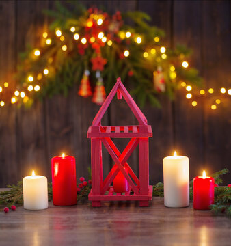 wooden lantern with candles and Christmas branchs on wooden background