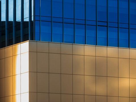 Architecture details Modern building Glass facade Background Blue tone
