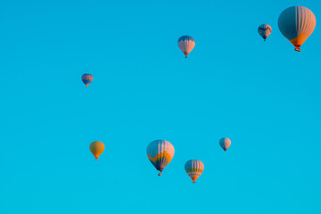 Hot air balloons on the sky in the morning. Magical view with hot air balloons.
