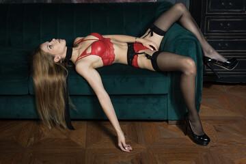 Obraz Strangled beautiful woman in a bedroom. Simulation of the crime scene..... - fototapety do salonu