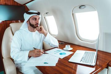 Fototapeta Business man from united arab emirates flying on his private jet to Dubai obraz