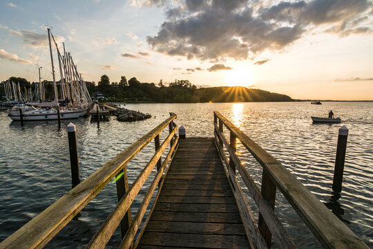 Wooden pier and scenic marina at sunset in Langballigau in Northern Germany