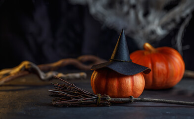 Mystical background of a witch. A decorative Halloween photo with a hat, pumpkins, spider webs and...