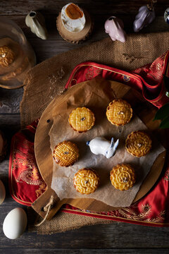 Mooncake a Chinese traditional pastry for Mid-Autumn festival. set on rustic wooden table.