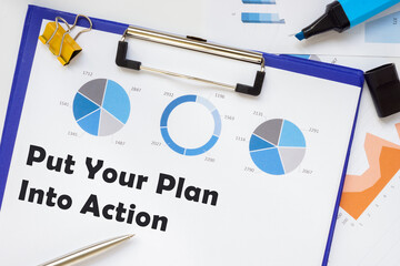 Financial concept about Put Your Plan Into Action with sign on the piece of paper.