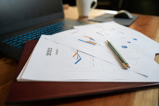 Paperwork and documents with financial plan for the year 2022