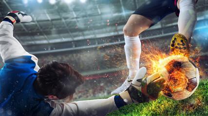 Obraz Goalkeeper tries to catch a fiery soccer ball - fototapety do salonu
