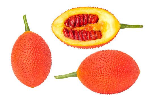 Fresh Gac fruit on a white background.