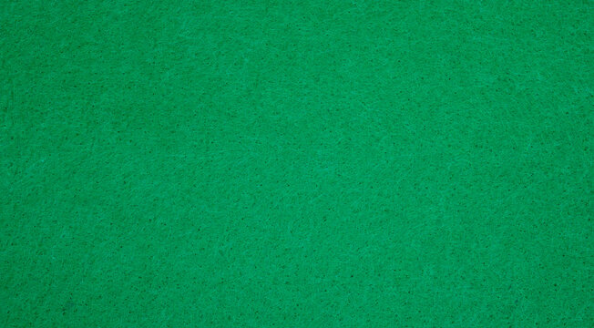 Close up of green flannel texture for a background.