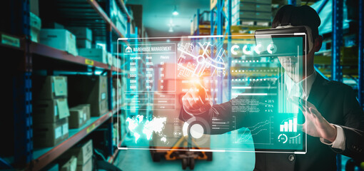Fototapeta Future virtual reality technology for innovative VR warehouse management . Concept of smart technology for industrial revolution and automated logistic control . obraz