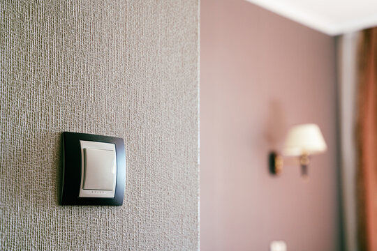 white light switch socket on wall