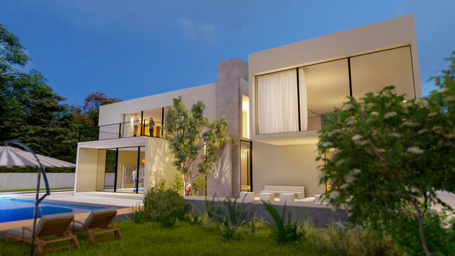 Big contemporary white villa with pool and garden in the evening