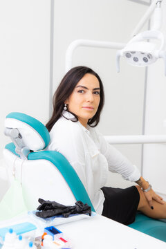 Beautiful brunette woman smiling in the dental chair.