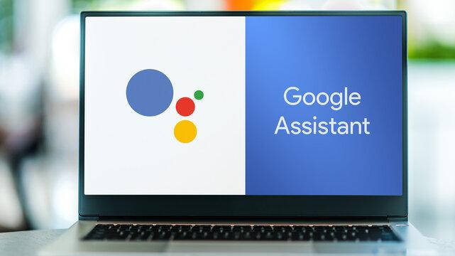 Laptop computer displaying logo of Google Assistant