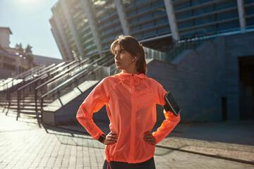 Obraz Sporty fit female workout using smartphone device - fototapety do salonu
