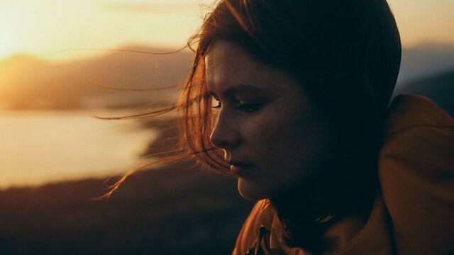 portrait of a woman at sunset in the mountains