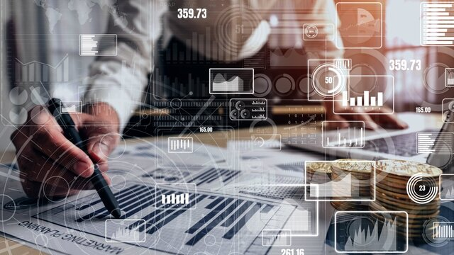 Big Data Technology for Business Finance Analytic conceptual. Modern graphic interface shows massive information of business sale report, profit chart and stock market analysis on screen monitor.