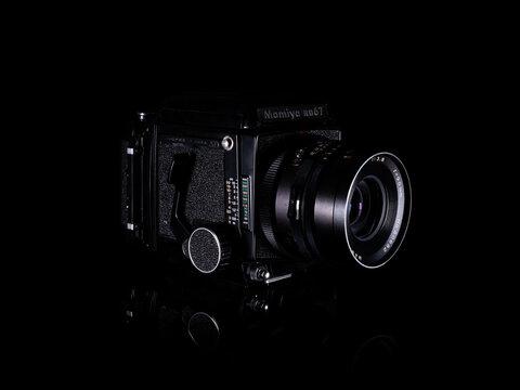 Fukuoka, Japan - october 10, 2021 : Mamiya RB67 pro SD professional medium format single-lens reflex film camera released in 1990 isolated on black background