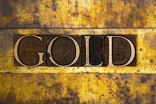 Gold text on textured grunge copper and vintage gold background