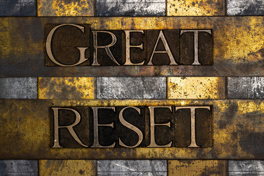 Great Reset text on textured grunge copper and vintage gold background