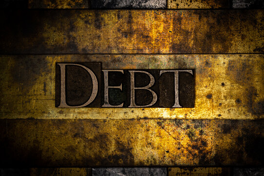 Debt text on textured grunge copper and vintage gold background