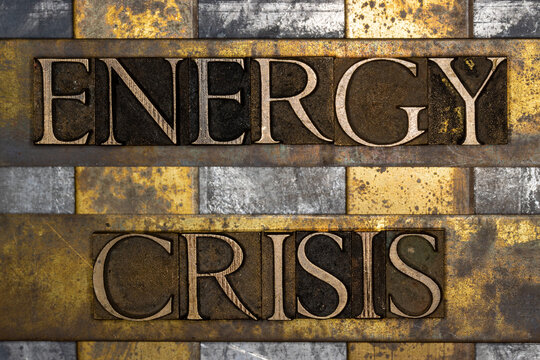 Energy Crisis text on textured grunge copper and vintage gold background