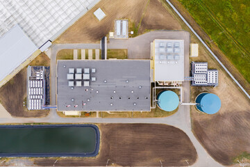 Fototapeta Industrial agricultural greenhouses for growing vegetables. Aerial view obraz