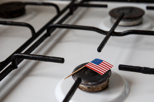 Natural gas exports and imports. High price. Flag of the United States of America on gas stove