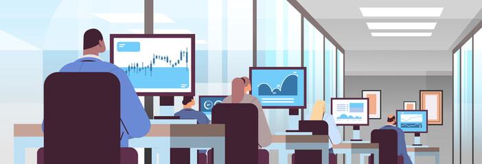 Obraz mix race traders stock market brokers analyzing charts or making presentation on computer monitors - fototapety do salonu