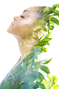 A profile portrait of an African American woman combined with an image of wild nature in a double exposure technique.