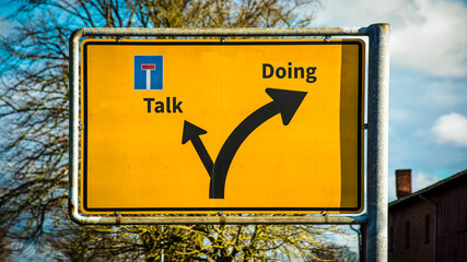 Obraz Street Sign to Doing versus Talk - fototapety do salonu