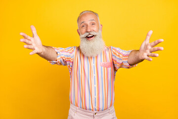 Obraz Photo of funny friendly age gentleman wear striped shirt smiling open arms inviting hugging isolated yellow color background - fototapety do salonu
