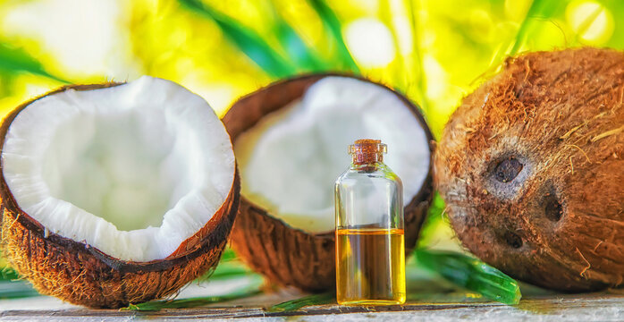 Natural coconut oil in a bottle. Selective focus.