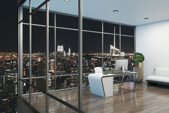 Modern designer office interior with workplace, night city view and other items. 3D Rendering.