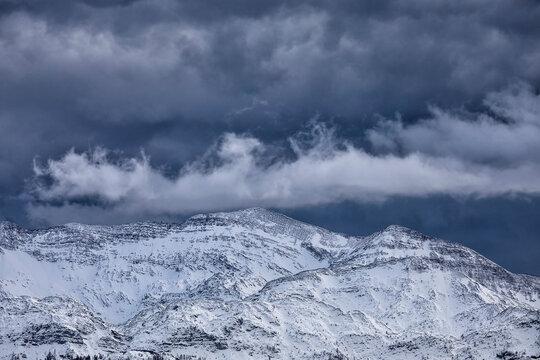 stormy sky over snowy mountain