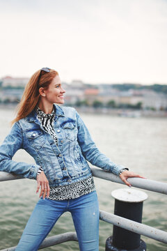 Happy positive redhead woman at riverside looking away