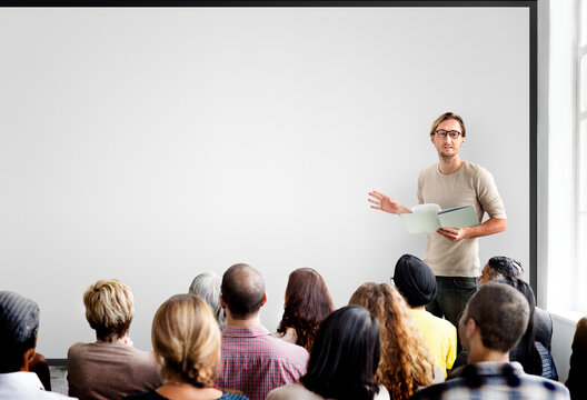 Guy giving a presentation to an audience