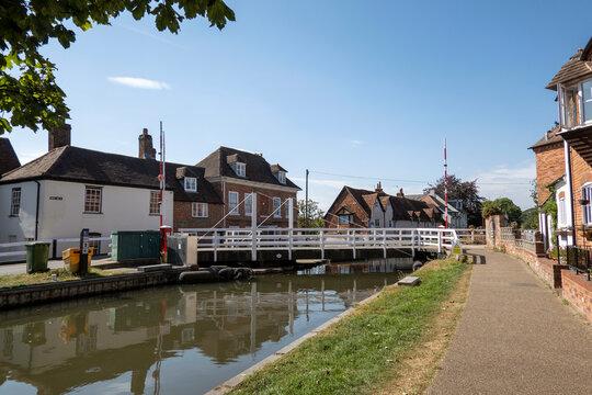 Newbury, Berkshire, England, UK. 2021.  White wooden swing bridge over the Kennet and Avon Canal at Newbury, UK