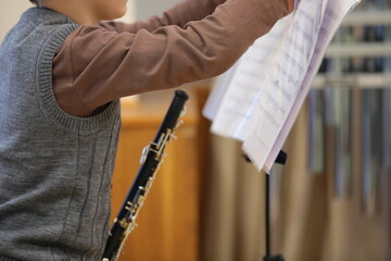 Child boy musician with musical instrument and notes prepares for music lesson.Happy childhood and...