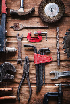 grungy old metal tools on a wooden background (processing cross-process)
