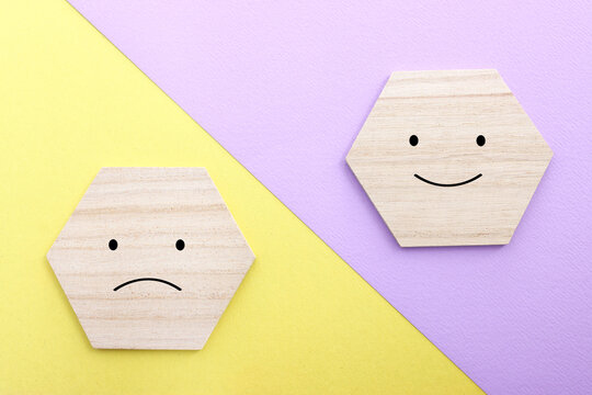 Concept image of satisfaction level. wooden cubes with emotions