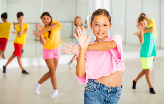 Dance class for kids, positive girls and boys training in dance studio