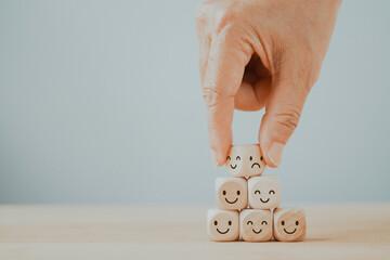 Fototapeta hand flip wooden cube, bad emoticon to happy, mental health assessment, world mental health day, change attitude  concept obraz