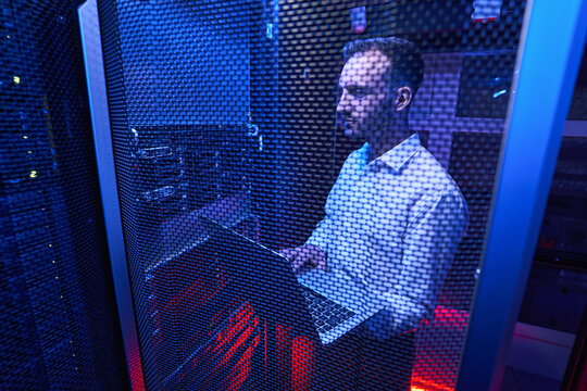 Professional system administrator maintaining data security in colocation center