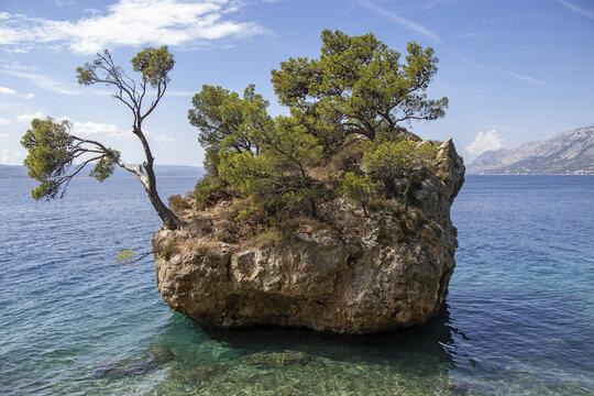 Small stone islet on Punta Rata beach in Brela