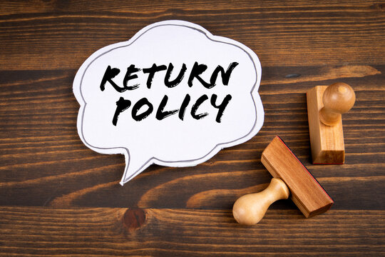 Return policy concept. Speech bubble and stamps on a wooden background